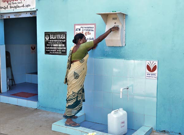 Durgavva 57, Im glad we're receiving purified drinking water displaying her ATW (Any Time Water) Card issued by Gram Panchayat