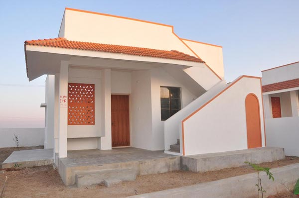 330 similar double bedroom house in 560 sq. feet area with sanitation facility inside the premises of the house, Purified drinking water provided to every household under Mission Bhagiratha Scheme were built within an year of time.